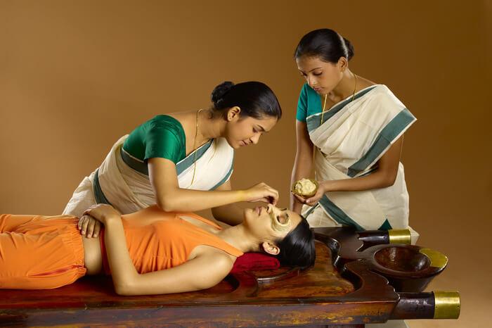 two Kerala women giving Ayurveda massage