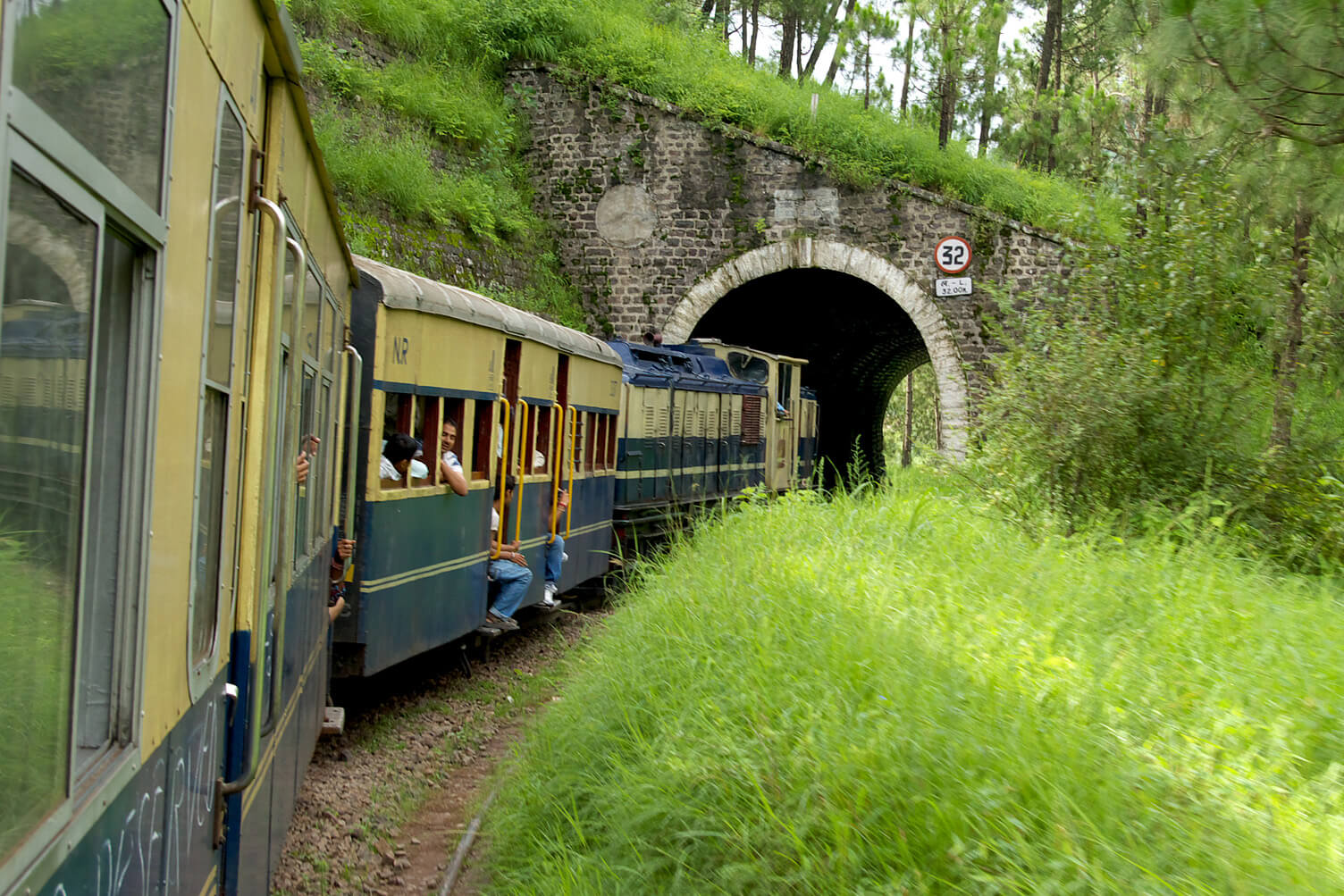toy train coming out of a tunnel