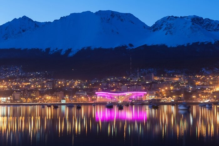 A night view of boats in the harbor at Ushuaia