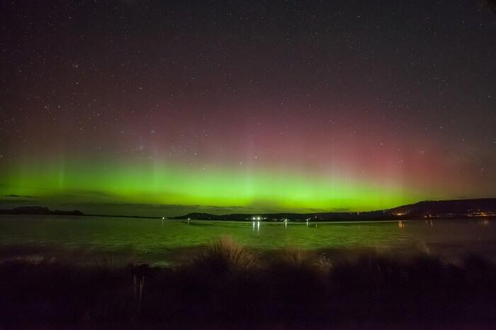 Beams of Aurora Australis over Cremorne Beach at Hobart