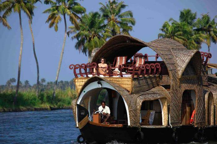 houseboat in Kerala with palm trees in the background