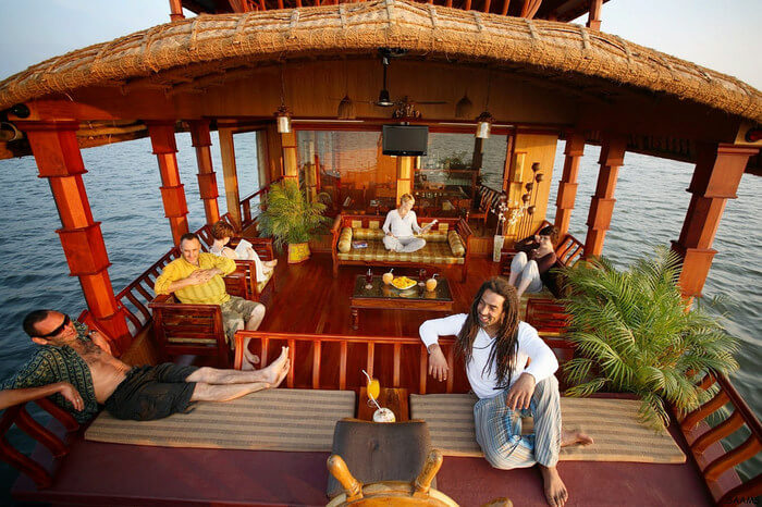 tourists relaxing on a luxurious houseboat