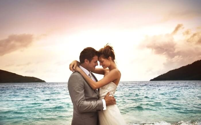 Romantic couple by the beach in Hayman Islands