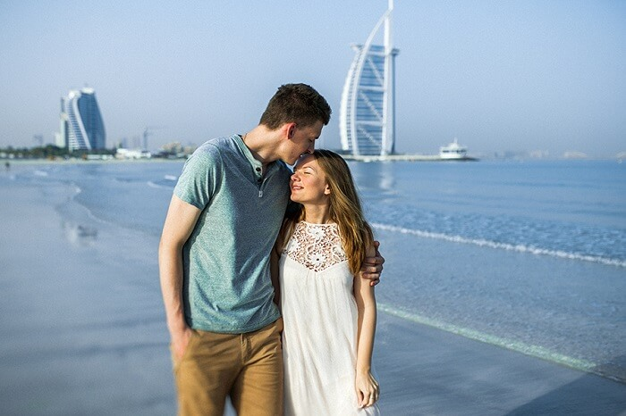 Romantic couple walking on the beach in Dubai