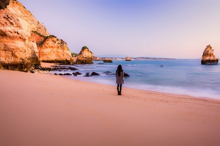 solo female traveler at the beach in Portugal