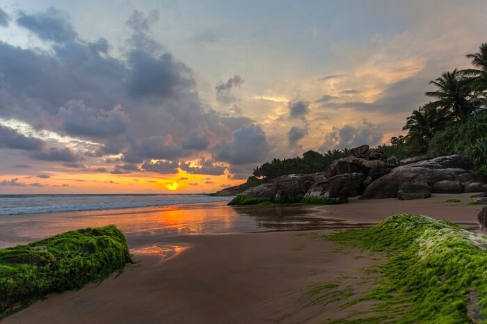 witness an amazing sunset in the beach
