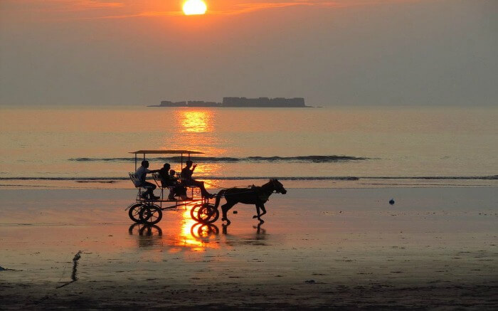 A bullock cart during sunset at Mandwa Beach