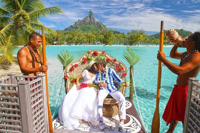 A couple kisses after getting married at Le Meridien in Bora Bora