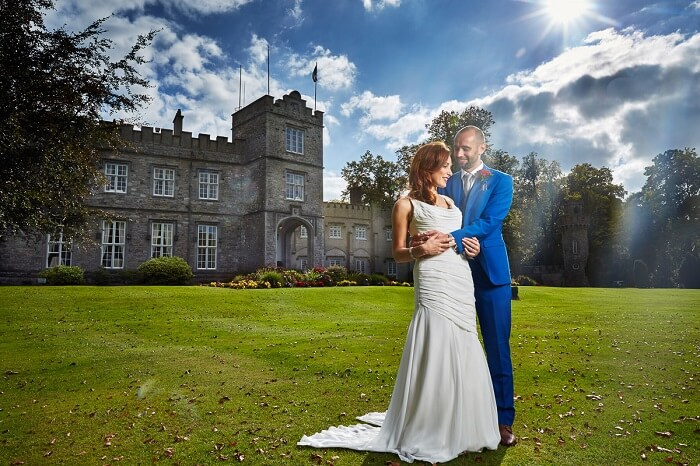 A couple poses for a wedding shoot at Luttrelstown Castle in London