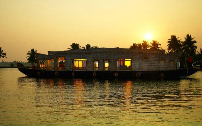 A houseboat in Kumarakom in Kerala at sunrise