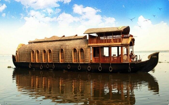 A houseboat in Kumarakom in the backwaters of Kerala on a beautiful dayss