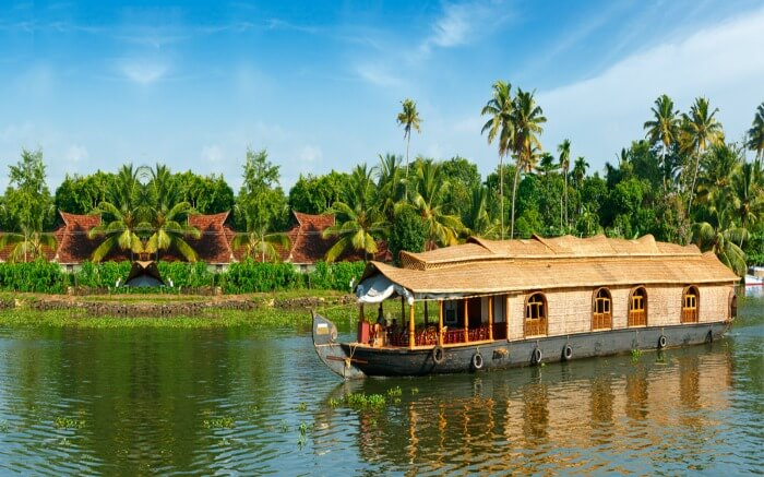 A view of Thathwamasi Premium Houseboats in the backwaters of Kumarakomss