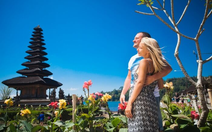 A couple near a Balinese Temple