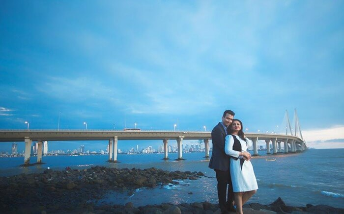 Shot of a couple in front of Sea Link in Band Stand Bandra