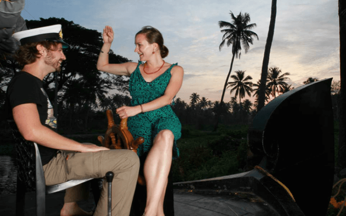 Couple sharing light moments together at Honeymoon Houseboat in Alleppey