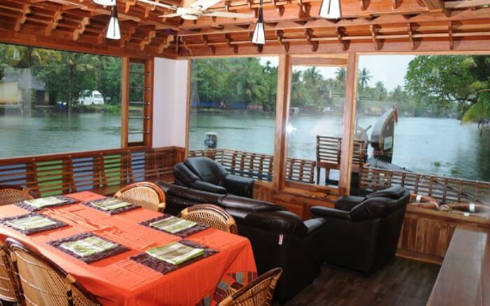 Dining space of Kumarakom Houseboat Holidays in Kumarakomss
