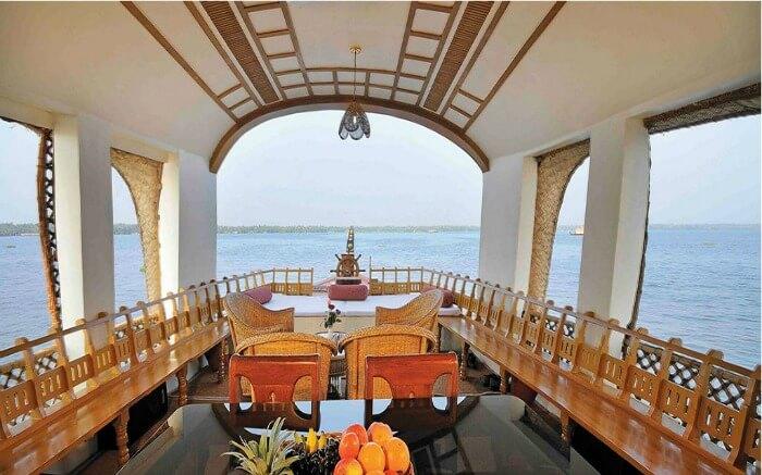 Dining space of a Kumarakom houseboat in Keralass