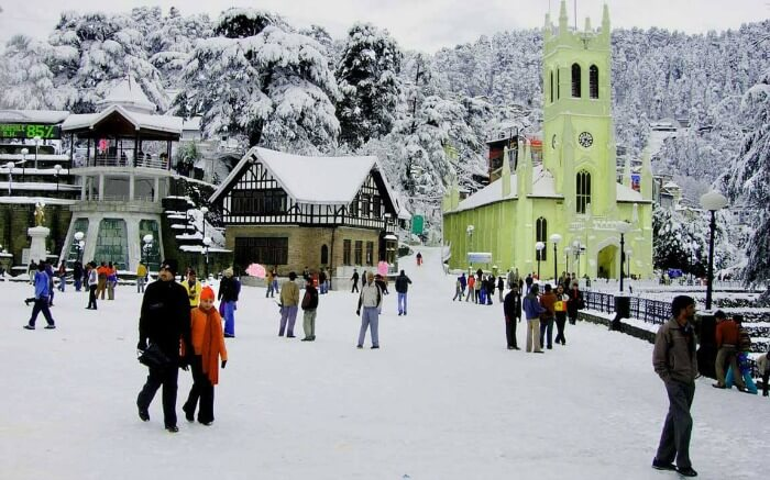 Honeymooners enjoying the fresh snowfall in Shimlas