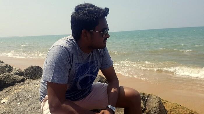 man chilling beach negombo