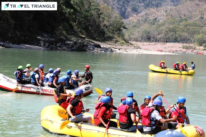 many enthusiasts riding a raft