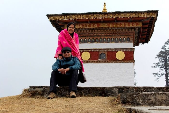 pradipranjan and his wife outside a monastery