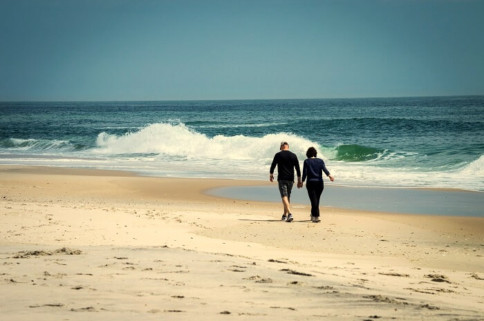 couple walking on beach in jersey