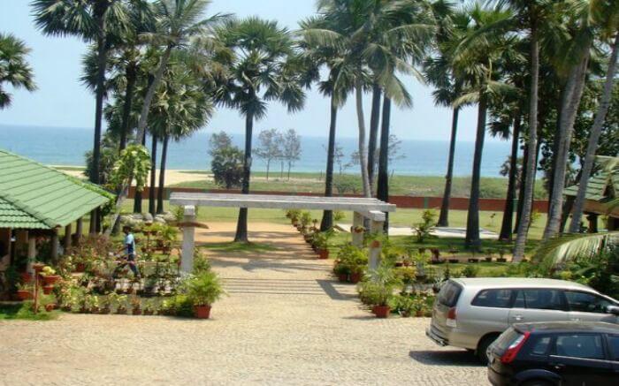 Lawn area of Nalla Eco Beach Resort overlooking sea in Pondicherry