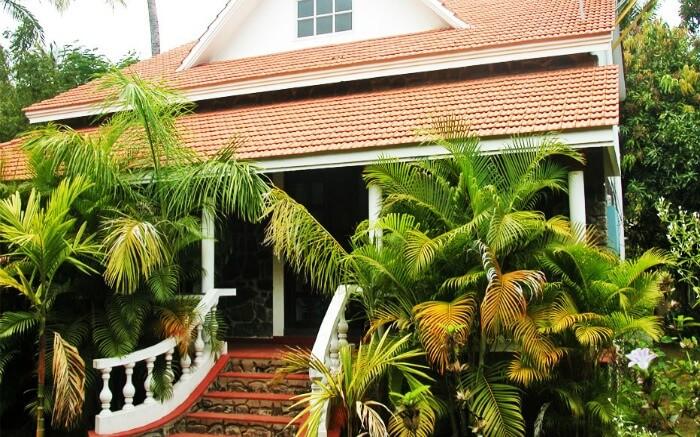 Prince Park Farmhouse entrance surrounded by palm plants