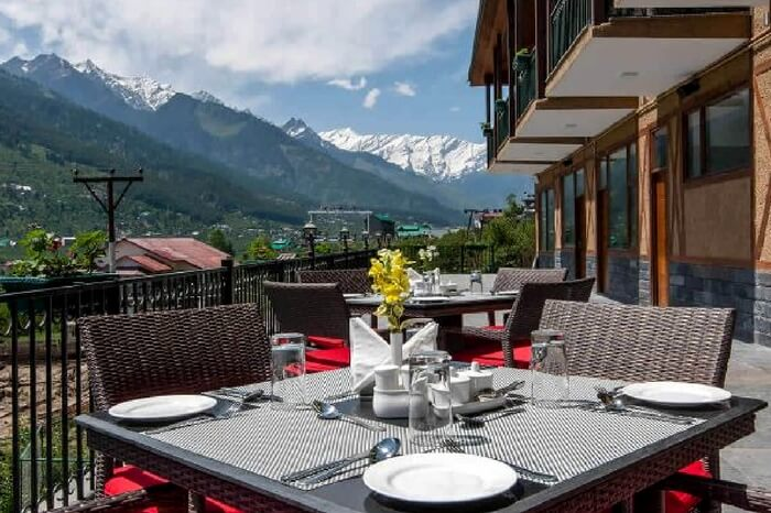 Open roof dining of Anantmaya in Manali overlooking mountains