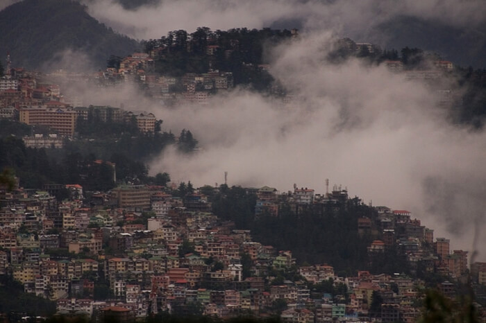 Top view of Shimla city covered in mist