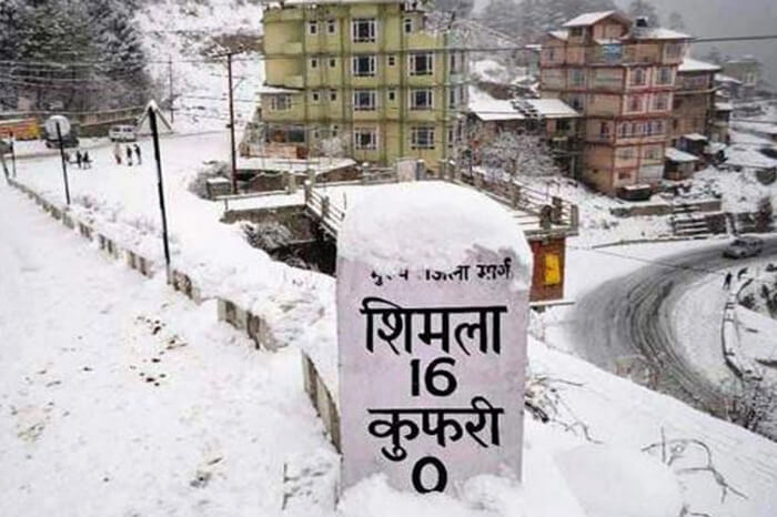 Milestone in Shimla covered in snow by the road
