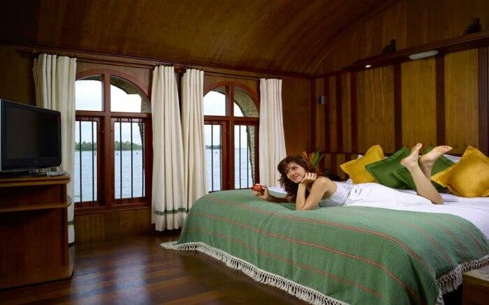 Traveler relaxing in a luxury stay of a Kumarakom houseboatss