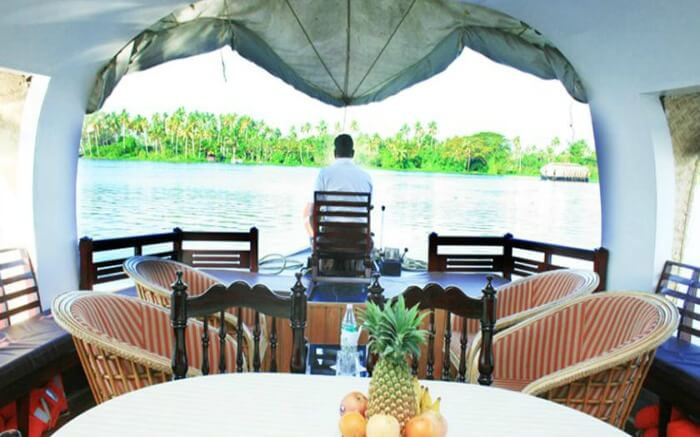 Well laid-out dining table with front deck of Welcome Cruise in Alleppey