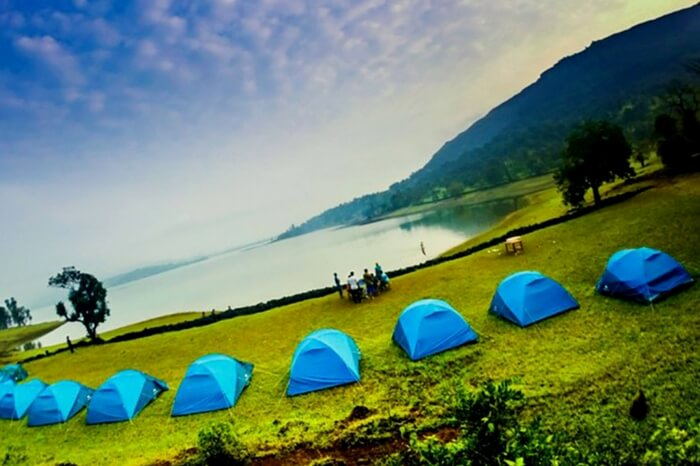 Camping site by the lakes in Bhandardara in Maharashtra in monsoon