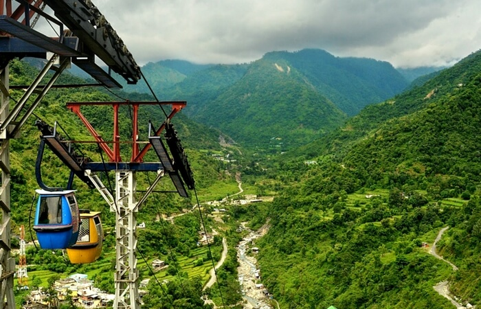 Cable car ride in lush green valley in Dehradun in Uttarakhand