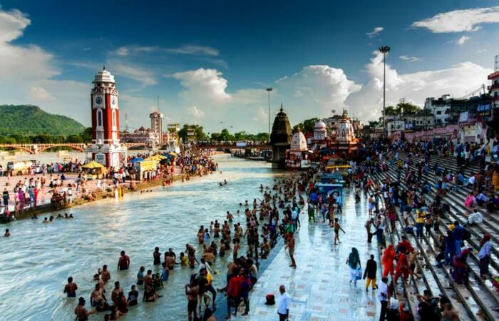 Pilgrims bathing by the banks of Ganges in Haridwar