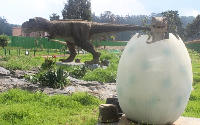 dinosaur egg and statue in an amusement park in Ooty