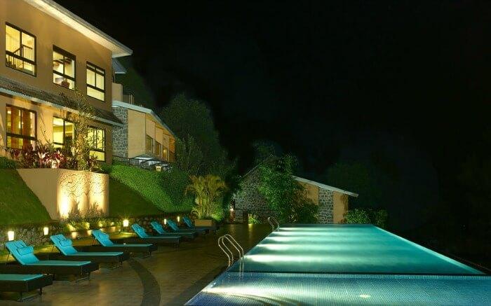 infinity pool at Poetree Sarovar Portico hotel in Thekkady