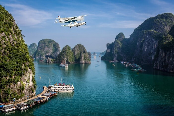 A seaplane flying over the Halong Bay near Hanoi