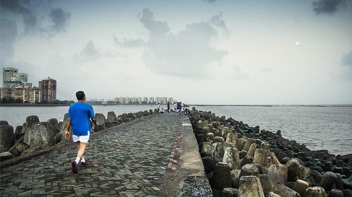 man walking marine drive nariman point