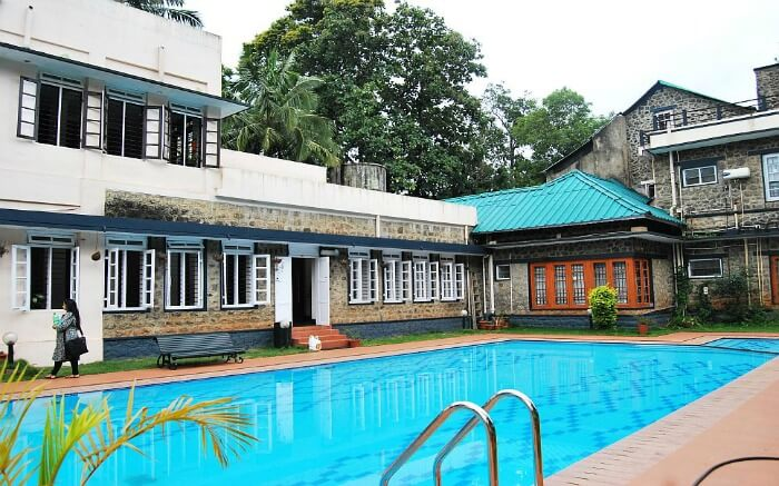 outdoor pool at hotel Aranya Nivas in Thekkady