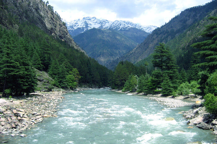 a river flowing in the middle of the mountains