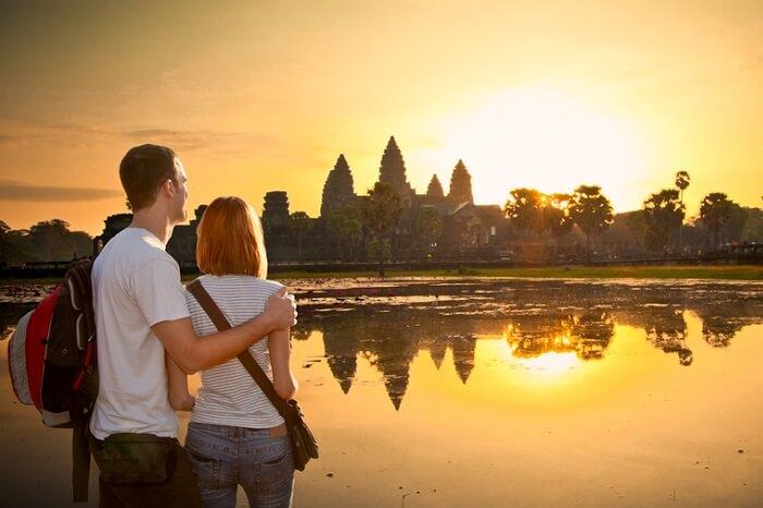 A couple at Angkor Wat at sunrise