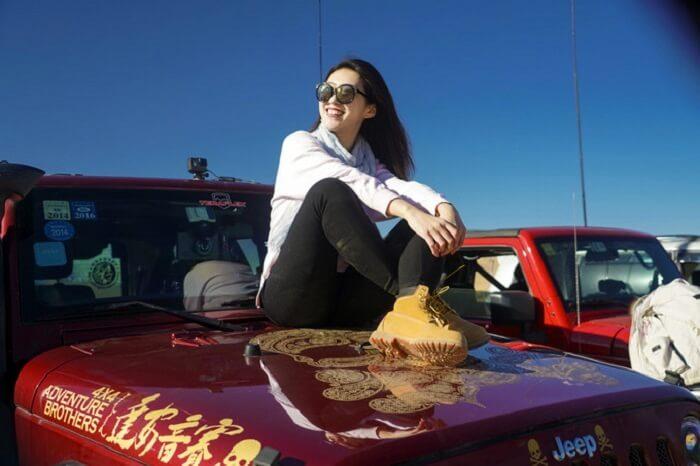 woman on car in ulan buh desert