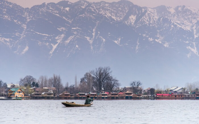 A boat crossing Nigeen lake in Srinagar in Kashmir