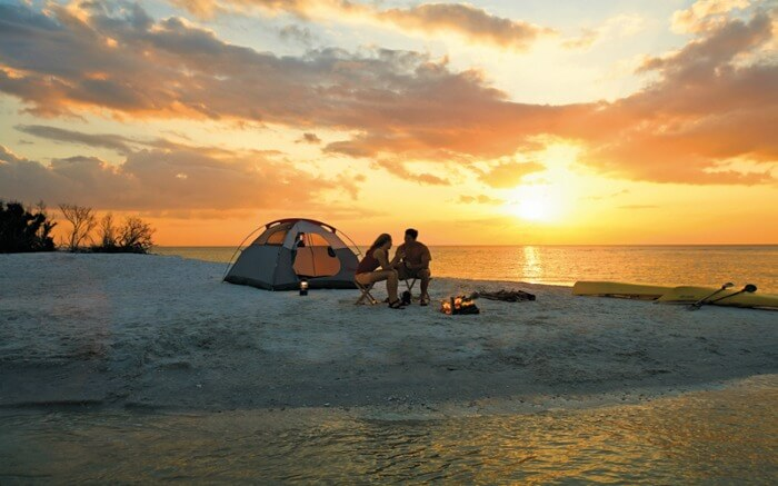 A couple camping on a beach