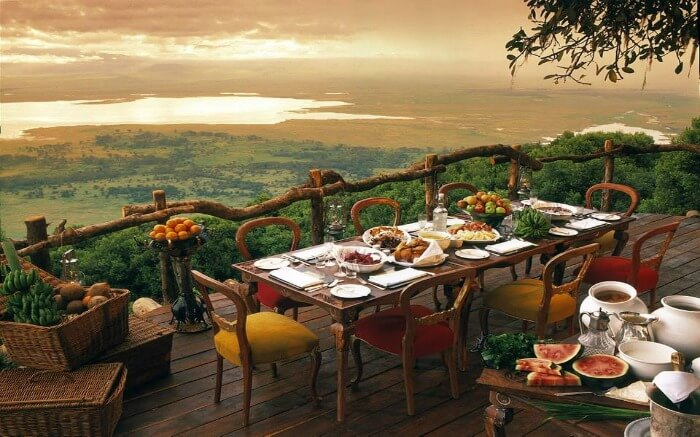 A lavish meal set in the open at a safari honeymoon lodge in Africa