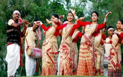 Assamese women and men dancing during Bihu festival