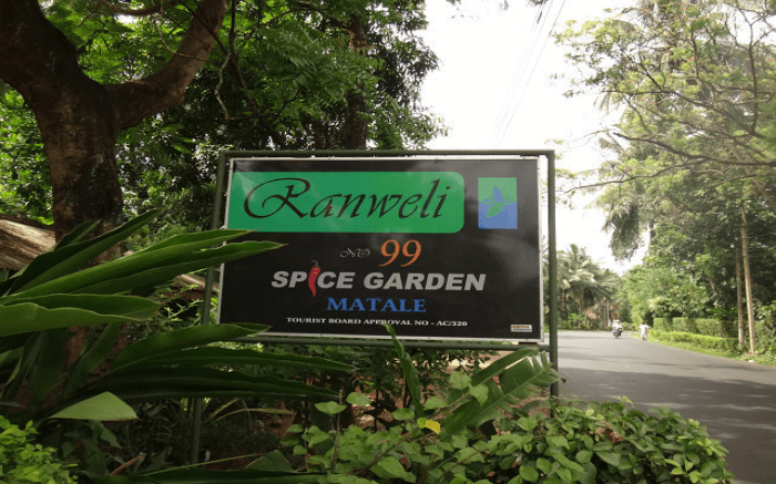 Board marking the arrival at Ranweli Spice Garden in Kandy
