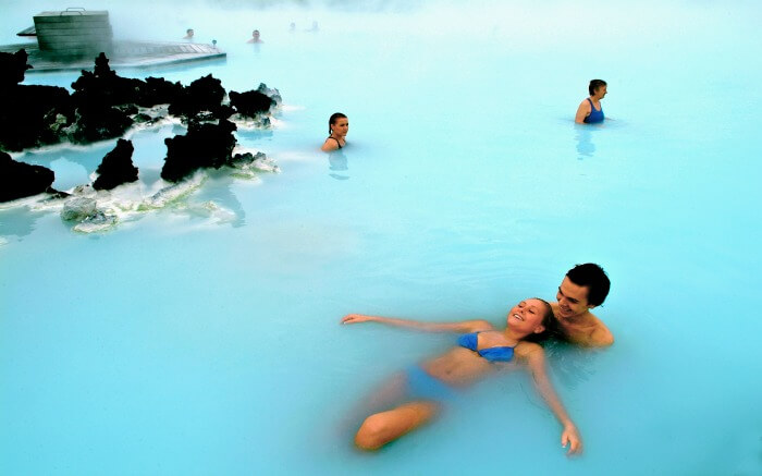 Couple enjoying romantic bath in Blue Lagoon in Iceland